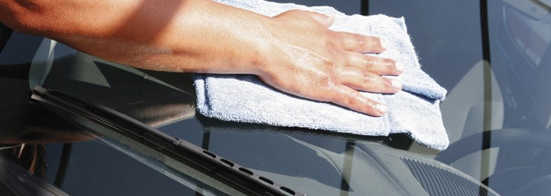 wiping-off-car-windshield